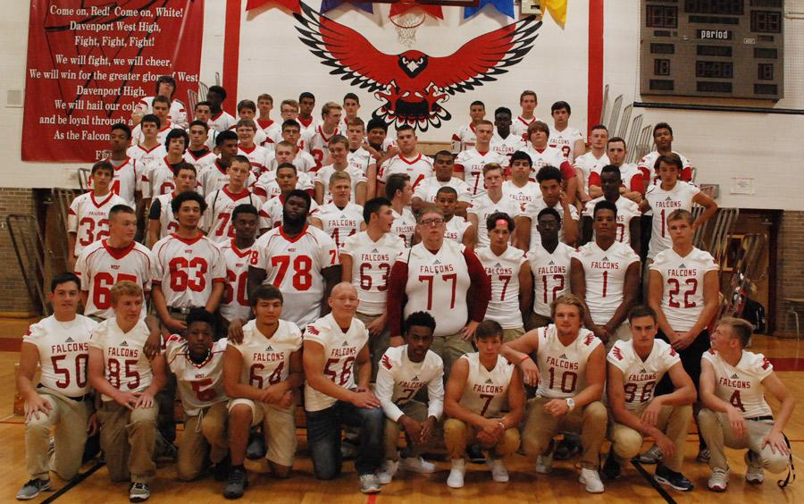 The football team poses after the pep assembly on Aug. 27 in the gym. They went on to win the game against North that night 16-14.