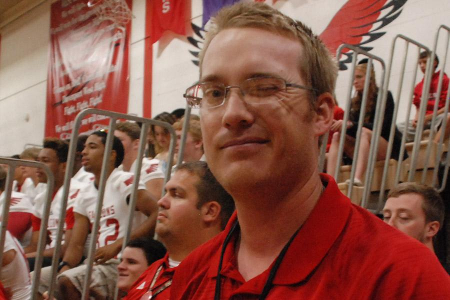 After leading the school in a cheer, football coach Justin Peters winks at the photographer during the pep assembly Aug. 28.