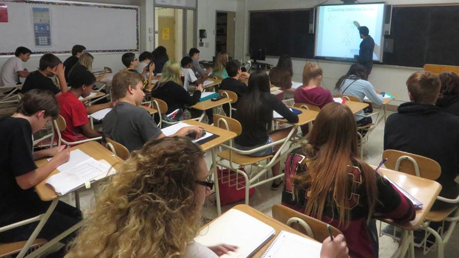 Students listen to Jared Perez explain a lesson in Algebraic Principles class during Block 4 on Aug. 26.