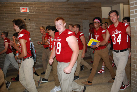 Hayden Heath walks with his teammates in a surprise parade down the halls during Block 4 on Sept. 4.