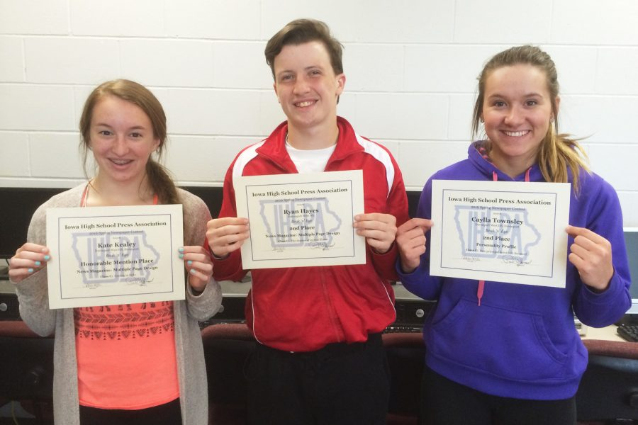Holding their newspaper awards are freshman Kate Kealey, senior Ryan Hayes, and senior Caylla Townsley.  Not pictured: Michael Leese, 2015 grad.