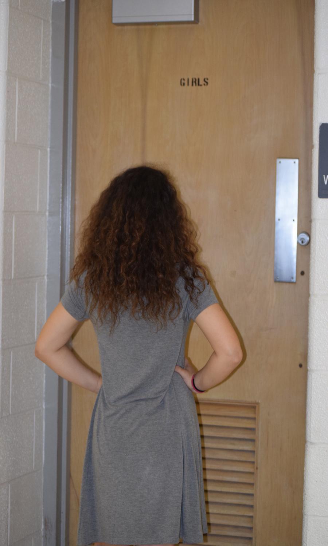 Tatiana Stepanek'18 standing outside a locked bathroom