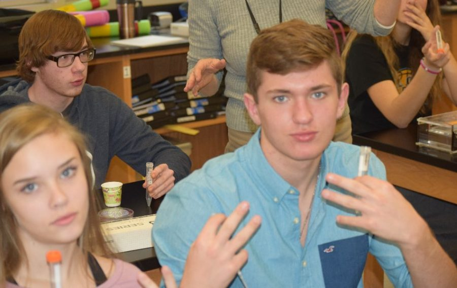 Students at west pose with their DNA.