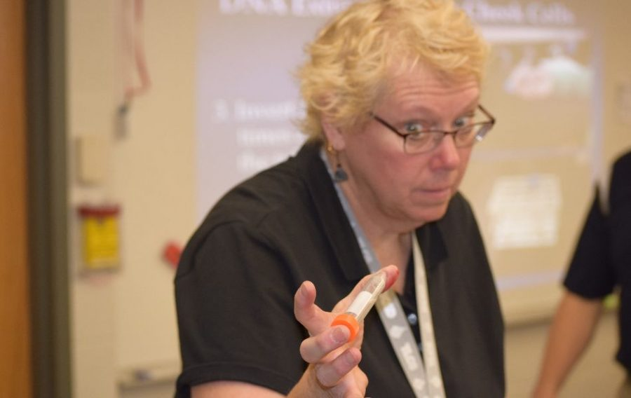 Mrs. Lietz shaking a bottle of DNA.