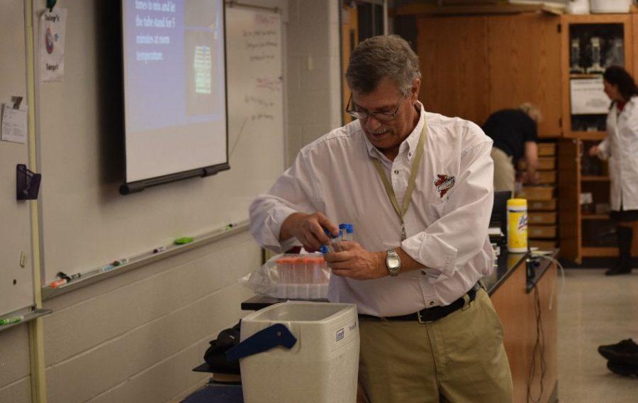 Mike Zeller, Professer at Iowa State is grabbing test tubes of ethanol.