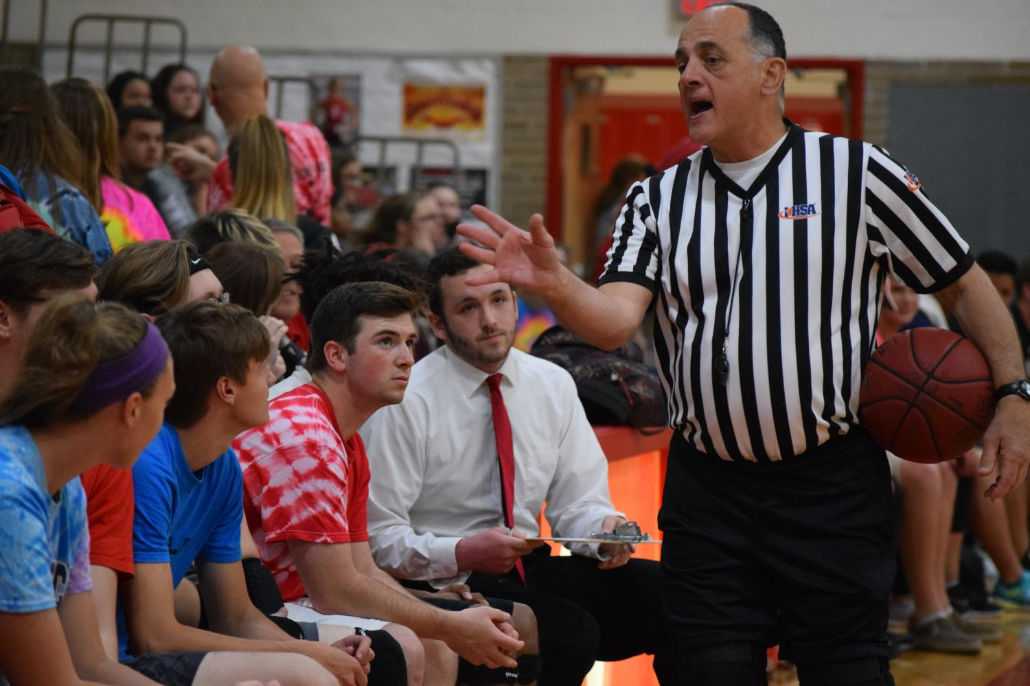 Referee Duquette discusses the rules with the student team