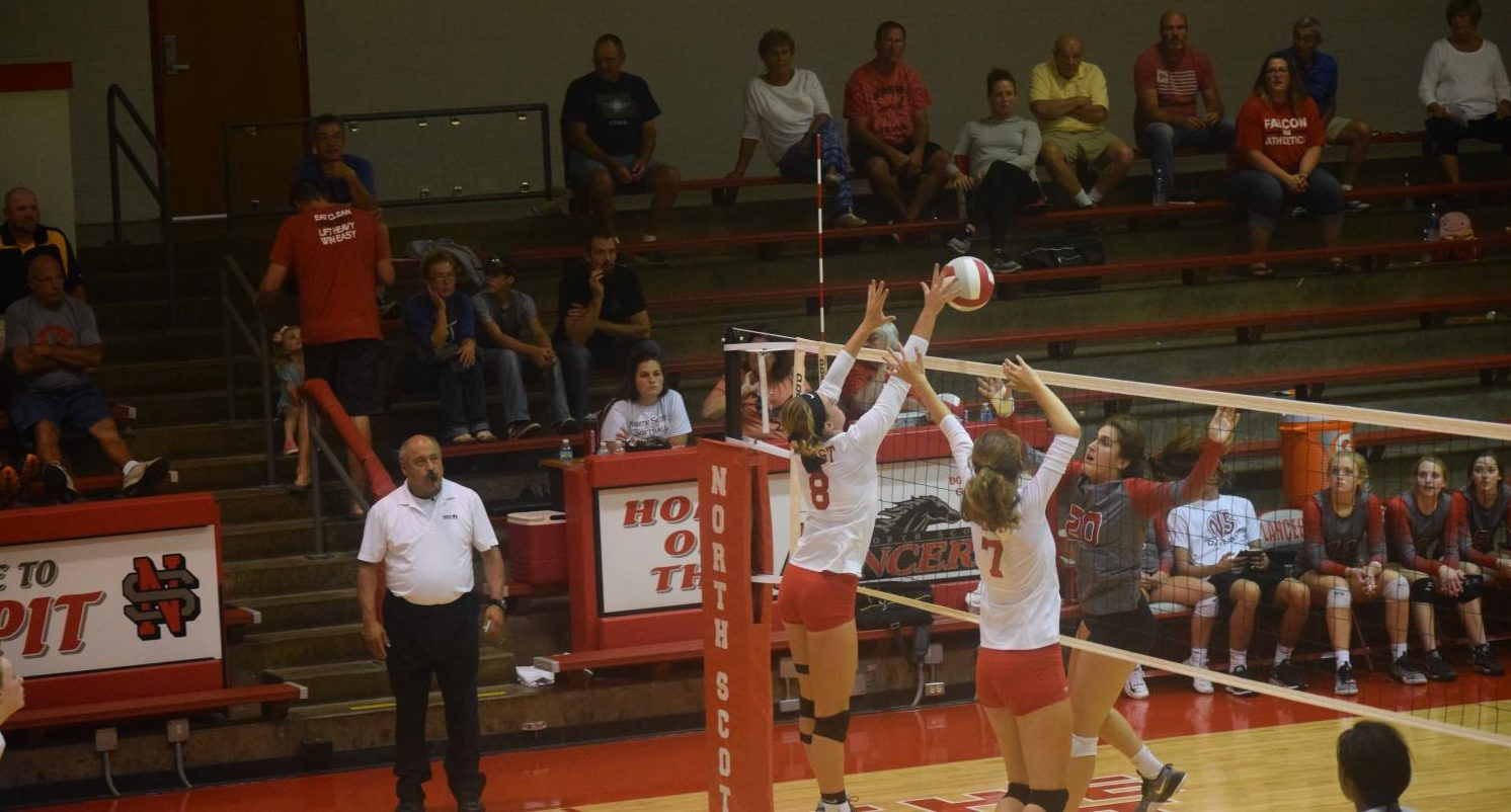 Varsity; Sara Weisrock and Abby Raterman blocking
