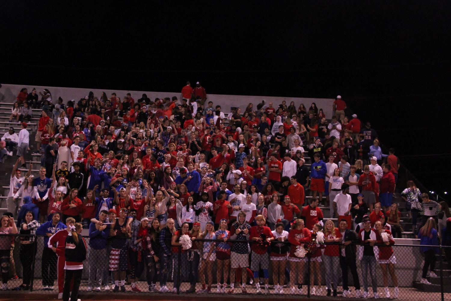 West+makes+a+differences+by+dedicating+a+football+game+theme+to+help+raise+money+for+hurricane+victims+in+Texas+by+dressing+in+there+state+flag+colors.+Students+ran+up+and+down+the+bleachers+collecting+money+for+the+victims.