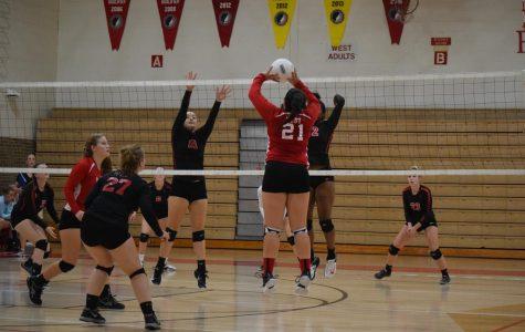 Falcon volleyball team faces the Clinton River Queens