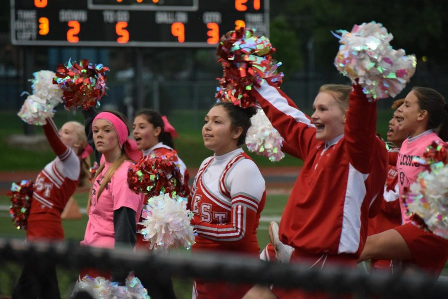 JV cheer squad hypes up the Falcon student section.