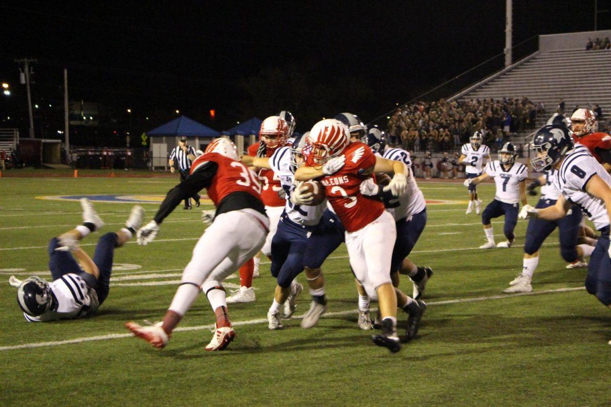 Varsity Tyler Conger gets tackled.