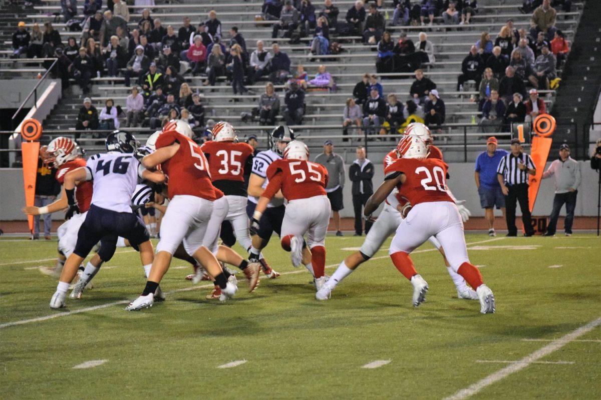 Varsity defense attempts to block PV.