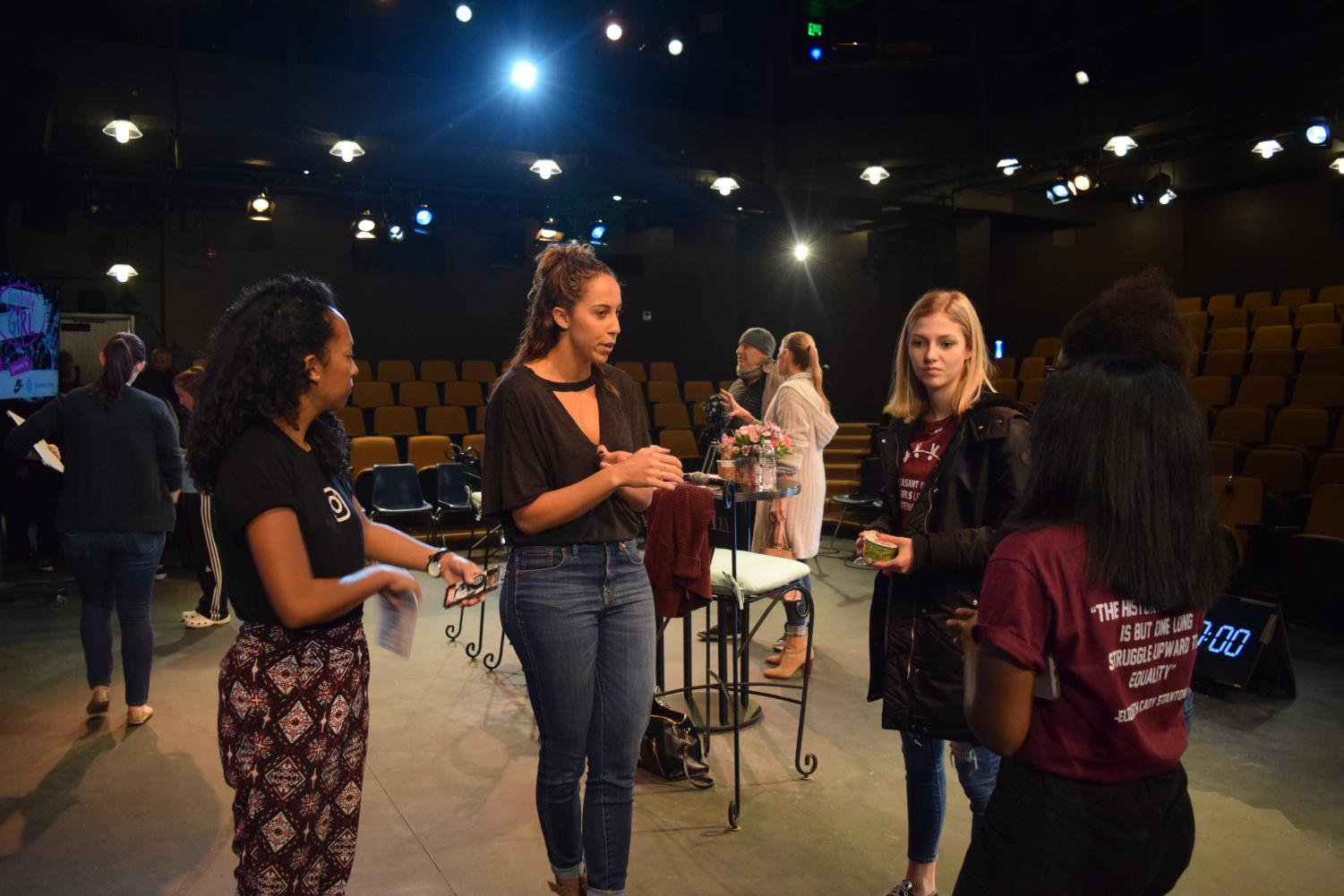 Professional American tennis player Madison Keys converses with Fearlessly Girl girls before show time.