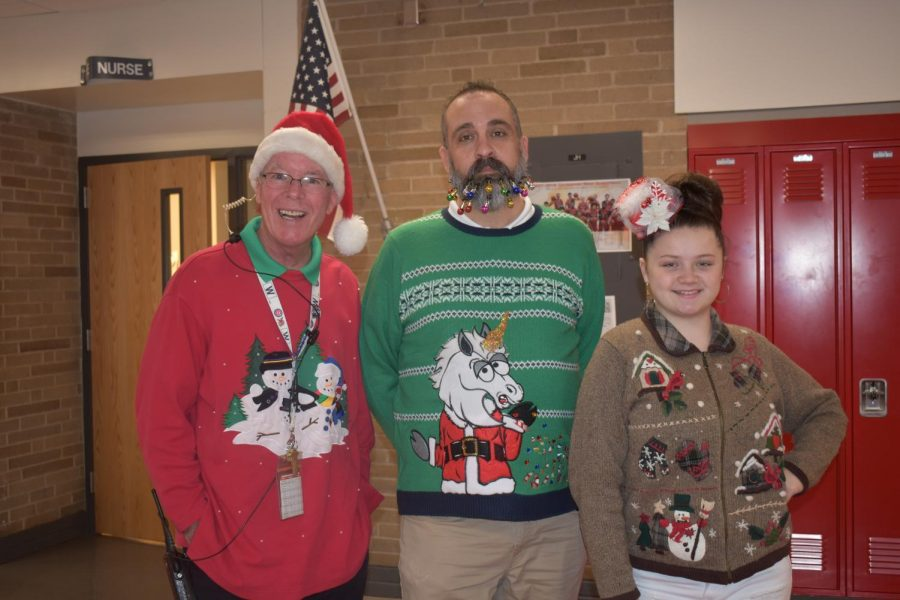Security guard Tim Freemole, associate principal Matt Hassig , junior Kassie Ramey and the rest of West spread hoilday cheer by dressin up and passing out candy canes to end the 2017 year.