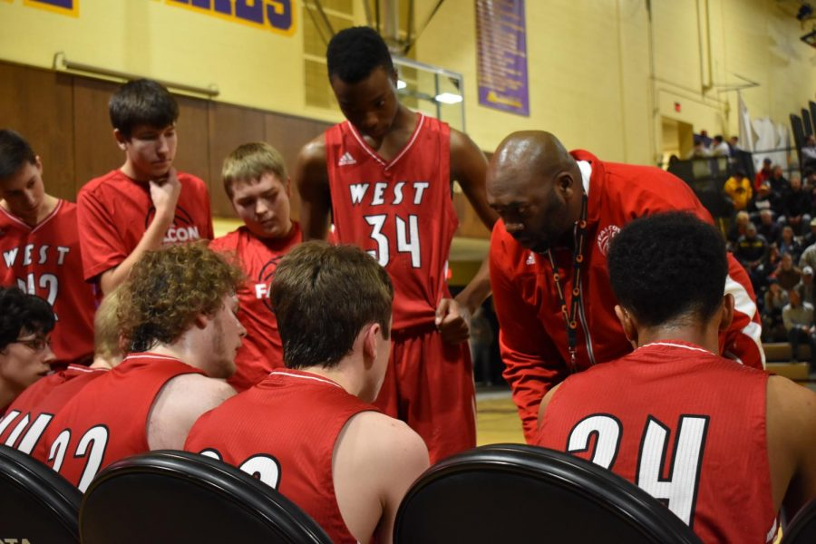 Coach Rob giving the boys a pep talk during a timeout.