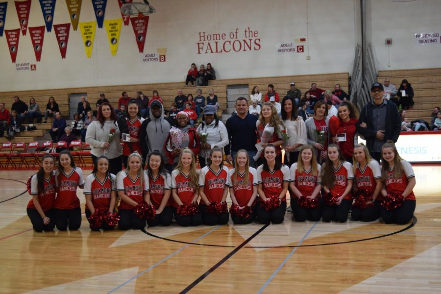 The entire team along with the 4 graduating seniors and their escorts.