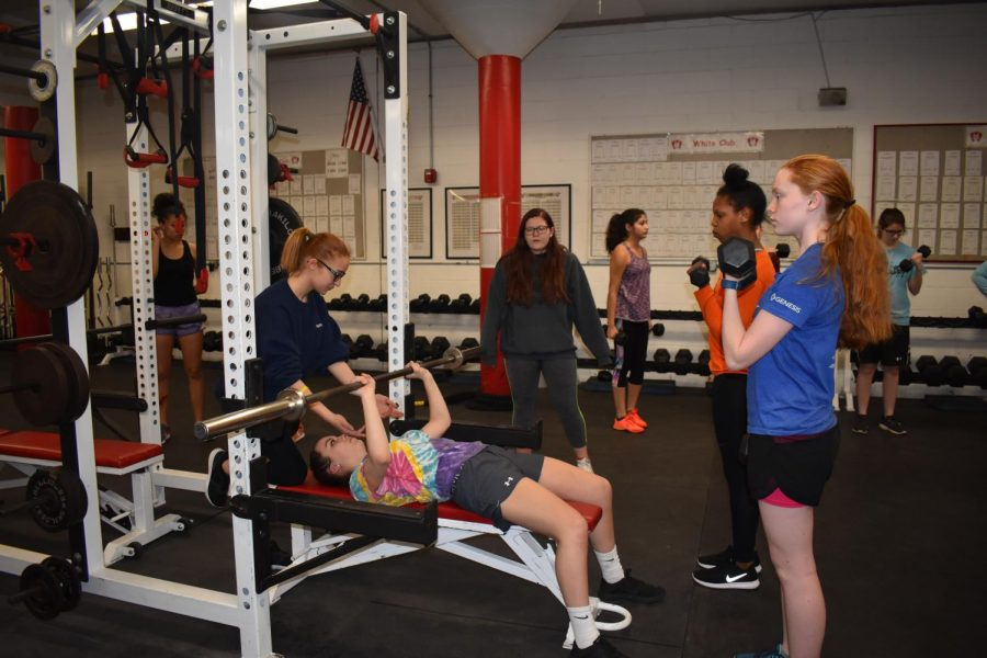 The team usually lifts two times a week before running. Workouts contain a variety of leg and arm workouts such as squats, bench presses, lunges and curls.
