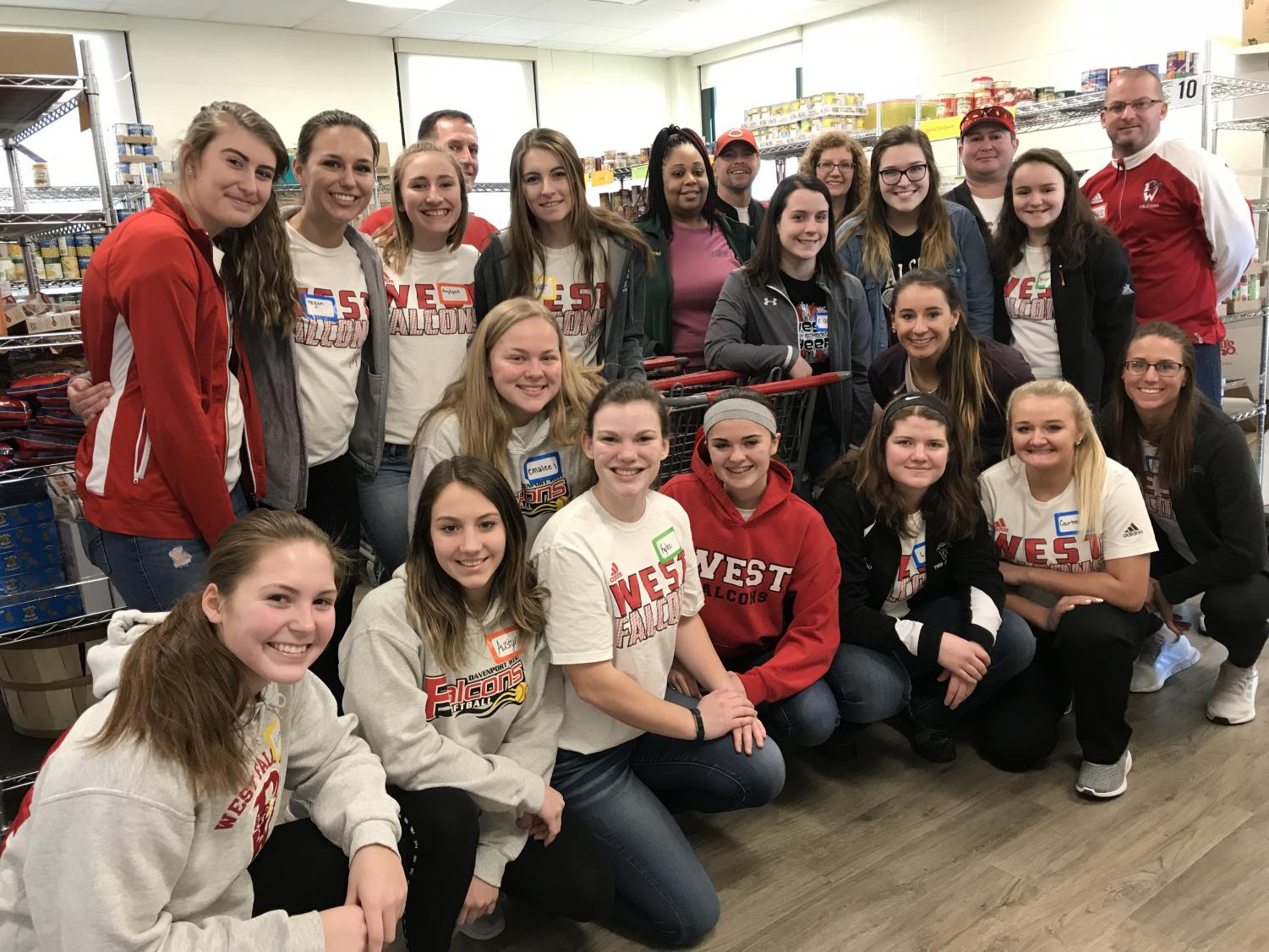 Some of the softball team and their coaches volunteering at the JB Young Food Bank.