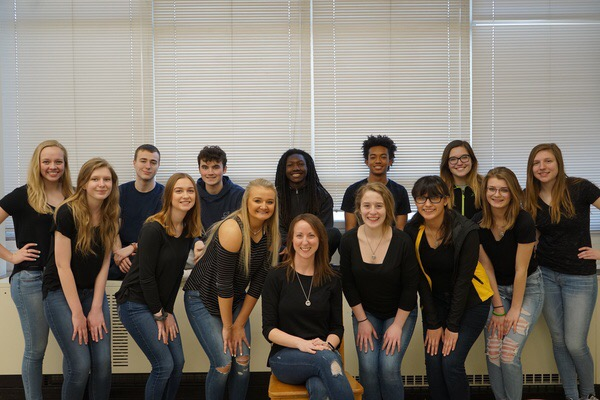 Everyone dressed in black and jeans for the annual Staber family photo in her AP English class.