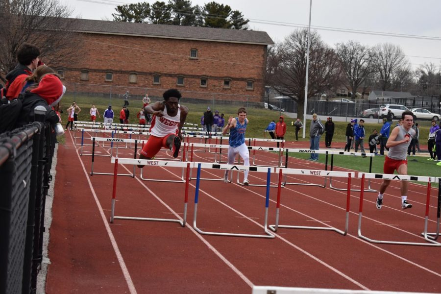 Senior Tyler Williams hurdling at one of the few meets that the boys track team had at Brady Street Stadium.