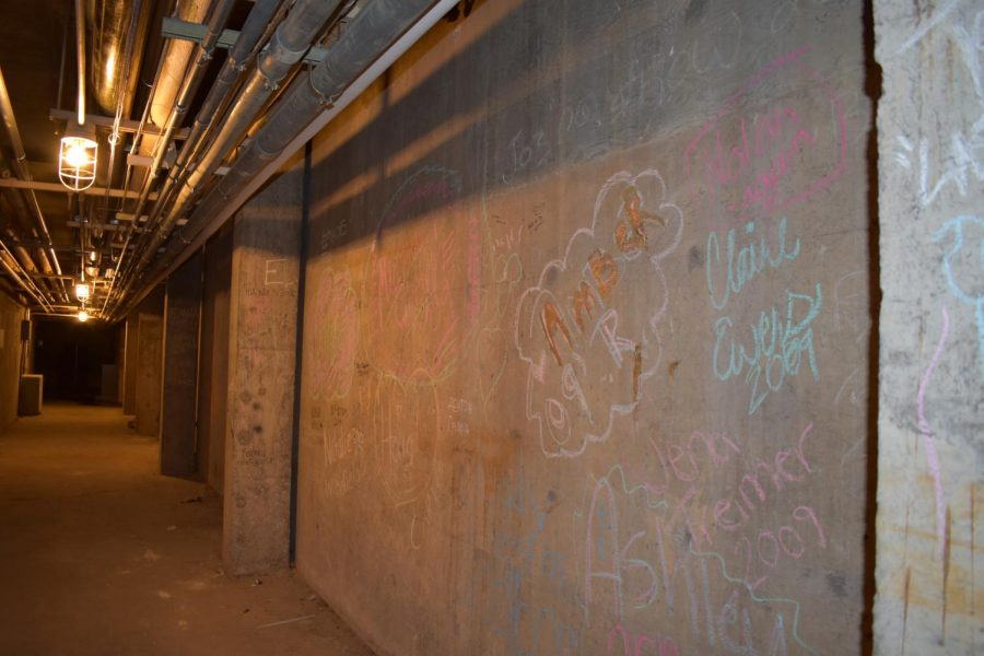 Teachers would allow students to take chalk or markers and write their names on the walls for a type of keepsake, head custodian Pat Clark said.