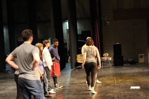 Choreographer Steph Delacy teaching the cast of