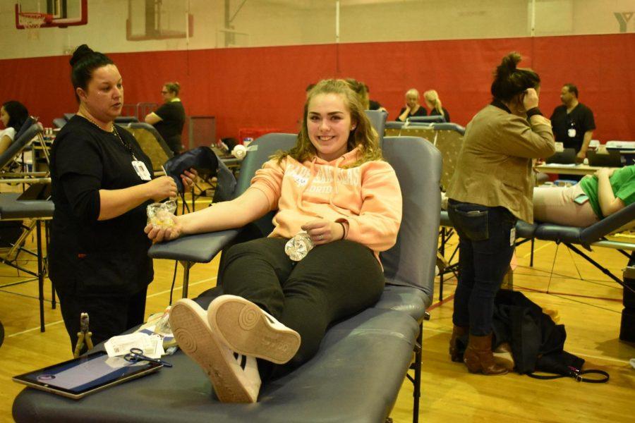 Junior Emma Day gives blood.