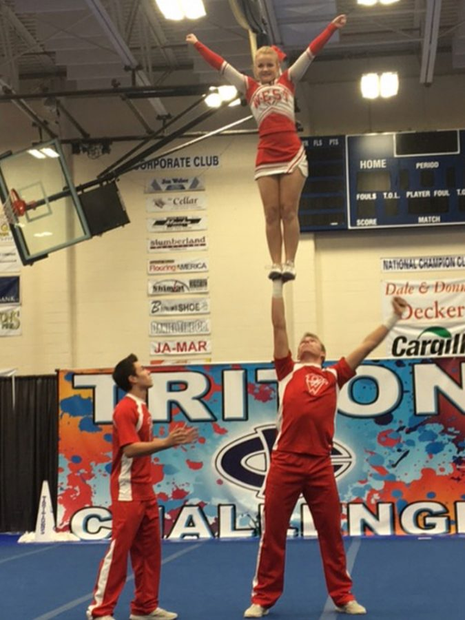 Aaron Gilliland won first place at state for partner stunting with Miranda Schwien as his flyer.