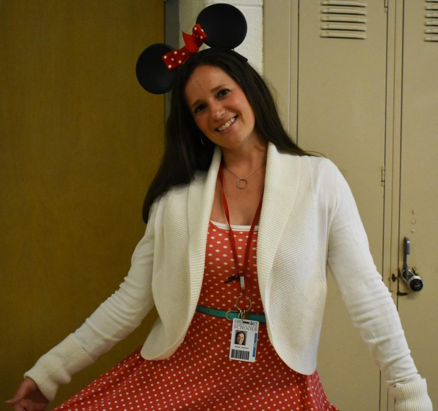 Spanish teacher Stephanie Hansen displays her Minnie Mouse outfit for Charity Week's Disney Day.