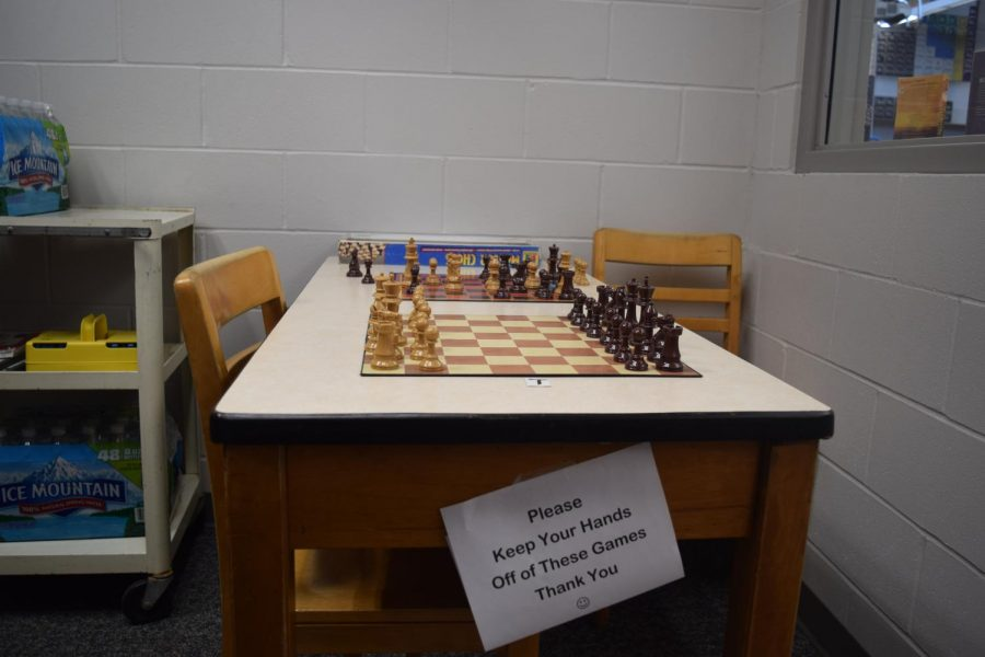 Here hangs a warning to other students to keep away from the chess board when there is a game in progress.