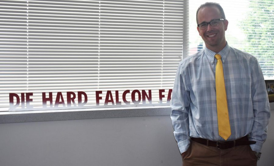 Associate principal Adam Pagett shows off his Falcon pride with his