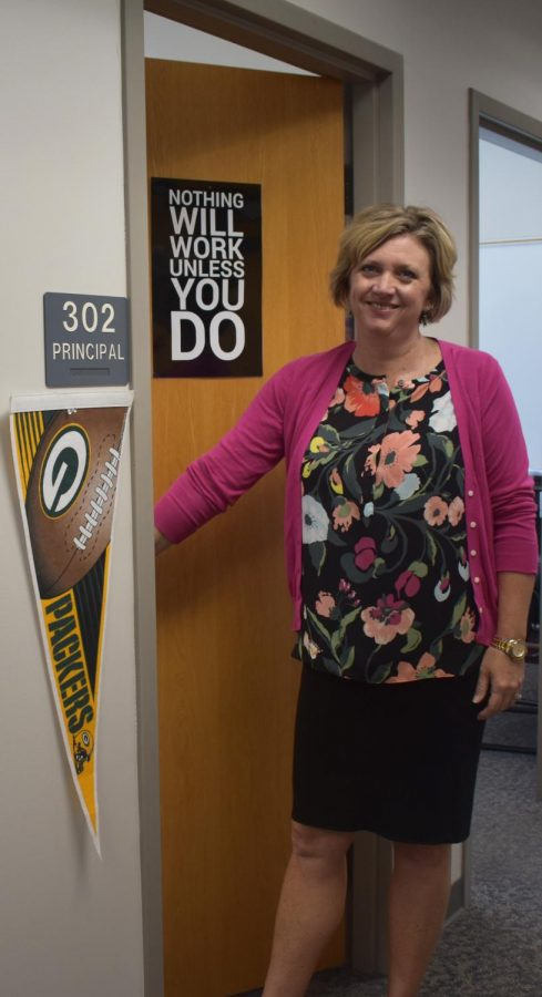 Williams decorated her door with a poster and a Packers flag to show her personality.