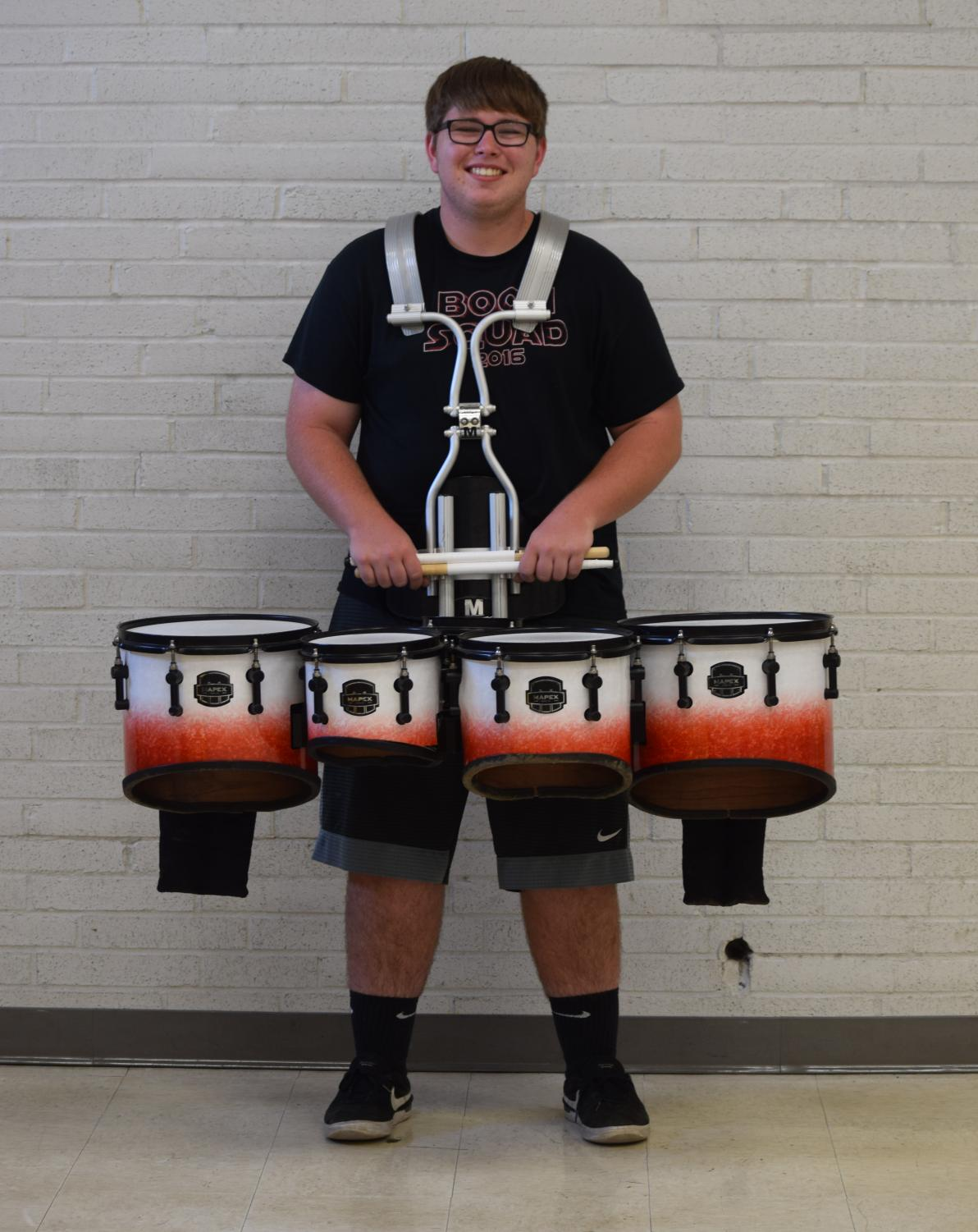 Kahley poses with his quince drum in the band room.
