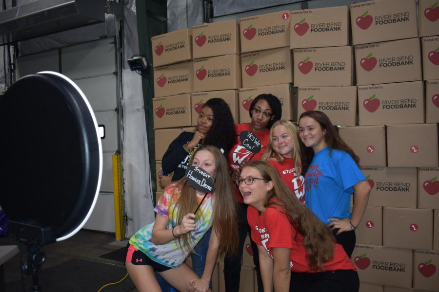 The Student Hunger Drive kick-off had a photo booth that students could take pictures in in front of the boxes they will be packing the non-perishable goods they have collected into.