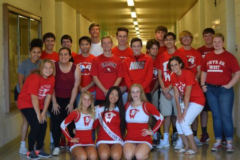 Students and staff show their school spirit by sporting red and white on 'Crazy Red and White Friday'.