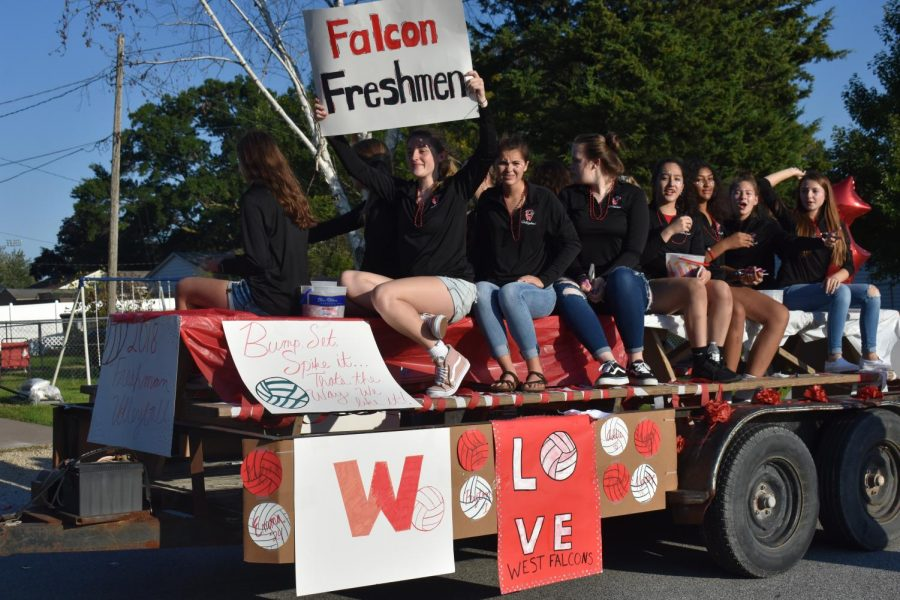 The freshmen volleyball team riding in their hand-decorated float at the homecoming parade.
