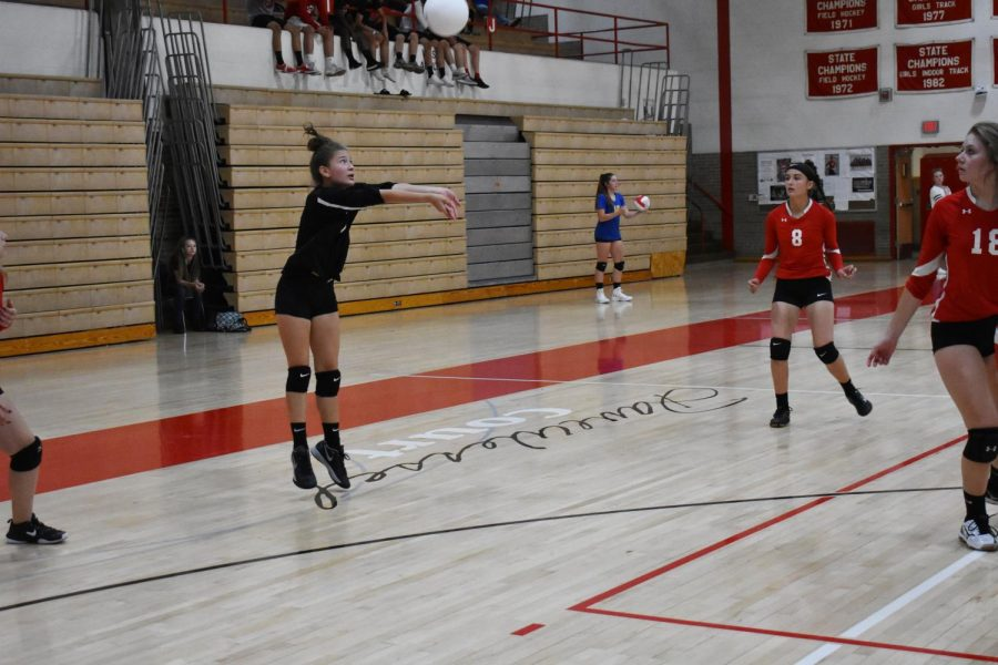 Libero Hannah Taylor puts the ball in play with a pass
