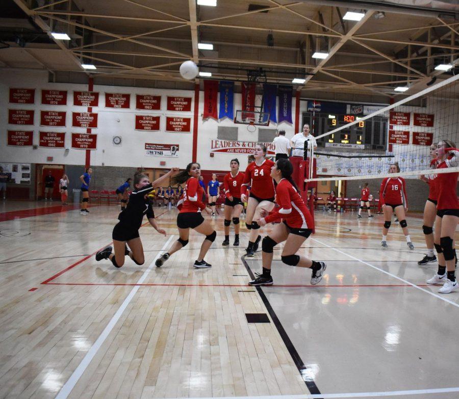 Libero Hannah Taylor dives to save the ball.