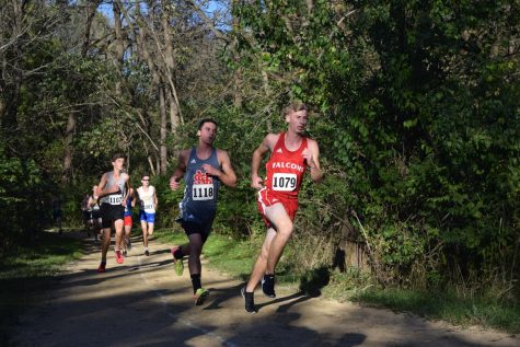 Senior Alex Schwindt pushes past a competitor.