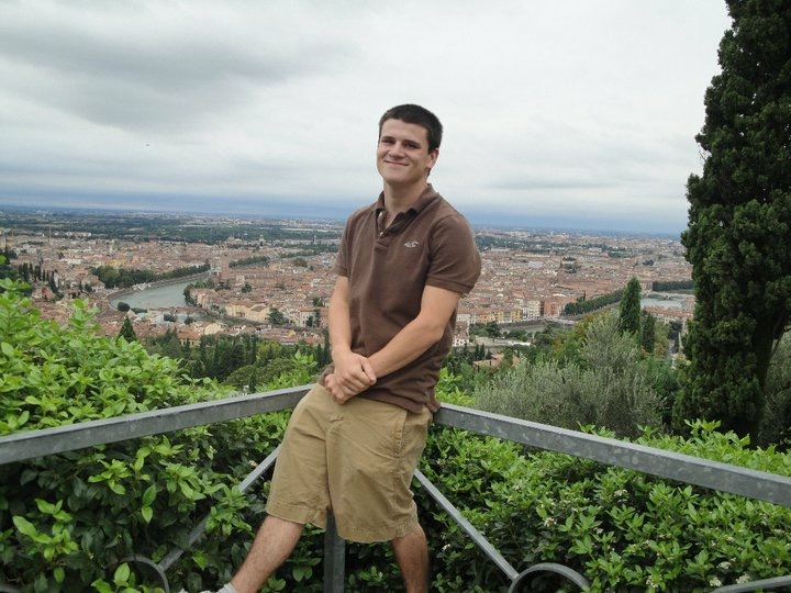 McCloud poses above a city in Verona, Italy.