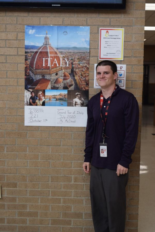 McCloud stands by the poster of ll Duomo di Firenze, Italy in the hallway.