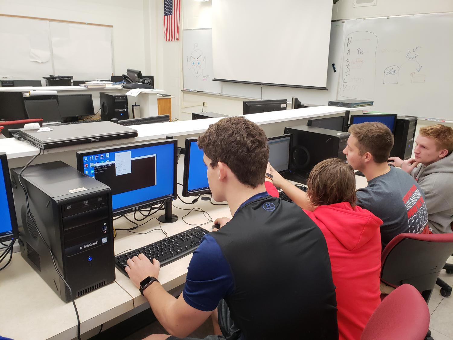 Seniors Jack Reis, Chase Thompson, Dusty Beehler, and Adam Gibson are working on Packet Tracer.
