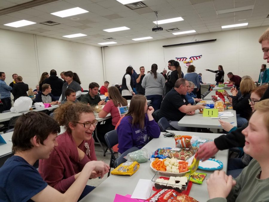 Trivia night participants enjoy their food while doing their best to answer the questions.
