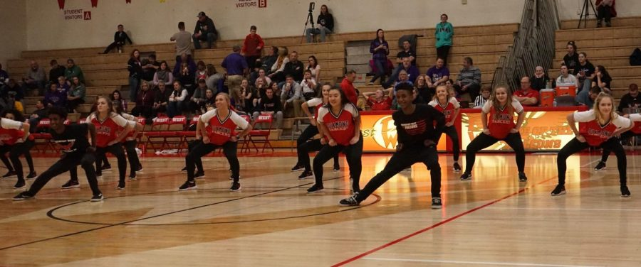 Freshmen Nasir and Nasiah Kolwey dance at the halftime show at the basketball game on Jan. 4th.