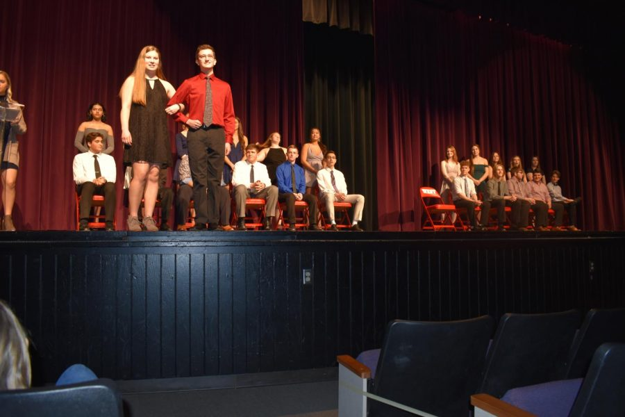 Fellow+Gala+court+candidates+watch+as+candidate+William+Zogg+is+escorted+on+stage+by+Emily+Ratermann.
