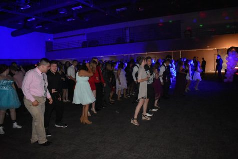 Many of the students attending the dance got up to dance to the cupid shuffle