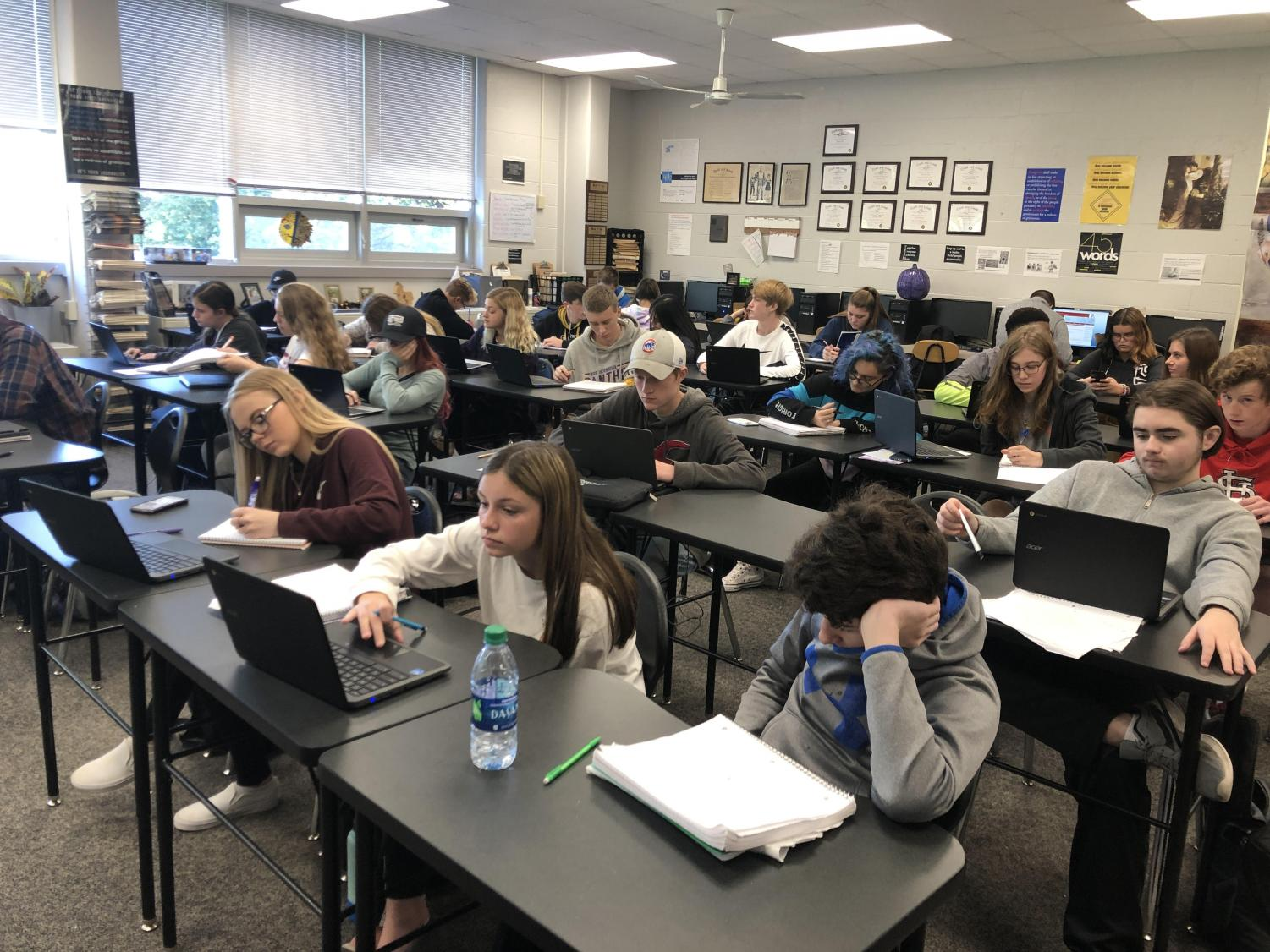 English teacher and newspaper adviser Alissa Hansen's Introduction to Newspaper class of 33 works hard on a social media webquest. Classes of this size are not hard to find, sometimes having more students than desks.