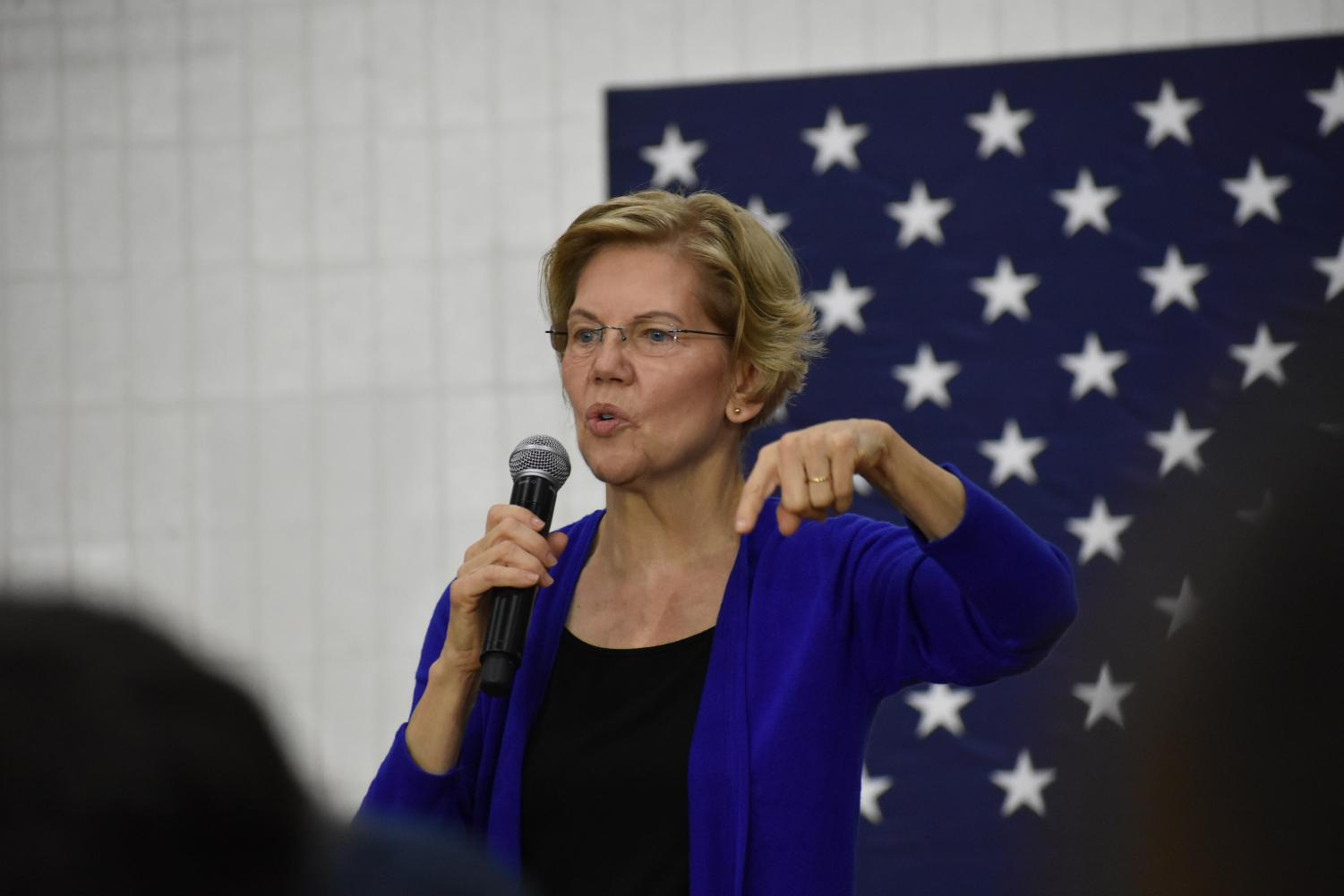Warren talks to the crowd. She addressed the crowd using hand motions to add emphasis and get them more involved as she spoke