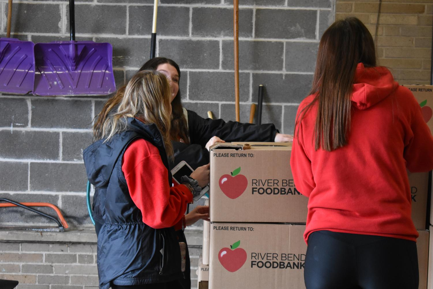 "Student Senate help box up food and load the trucks on delivery day on Thursday, Nov. 14. West collected over 21, 000 pounds of food. ""I think that the most successful part of the Hunger Drive was bringing the school together,"" Student Senator and senior Madison Fuller said"