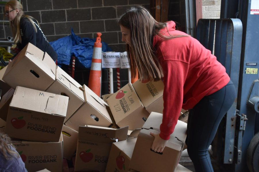"West collected almost 14 pounds of food per student for the 2019 Hunger Drive with a total of 21, 068 pounds""I really enjoyed working the mobile food pantry. I enjoyed it because everyone was so happy they were getting food,"" Student Senator and senior Erica Henderson said"